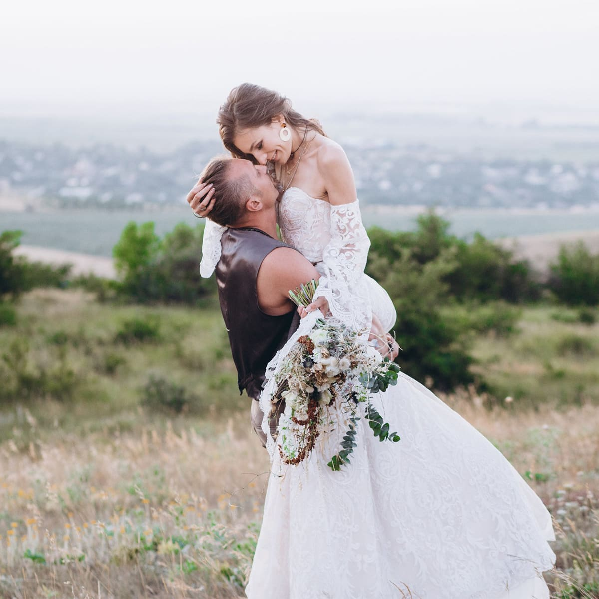 Bride and groom embracing on their wedding day