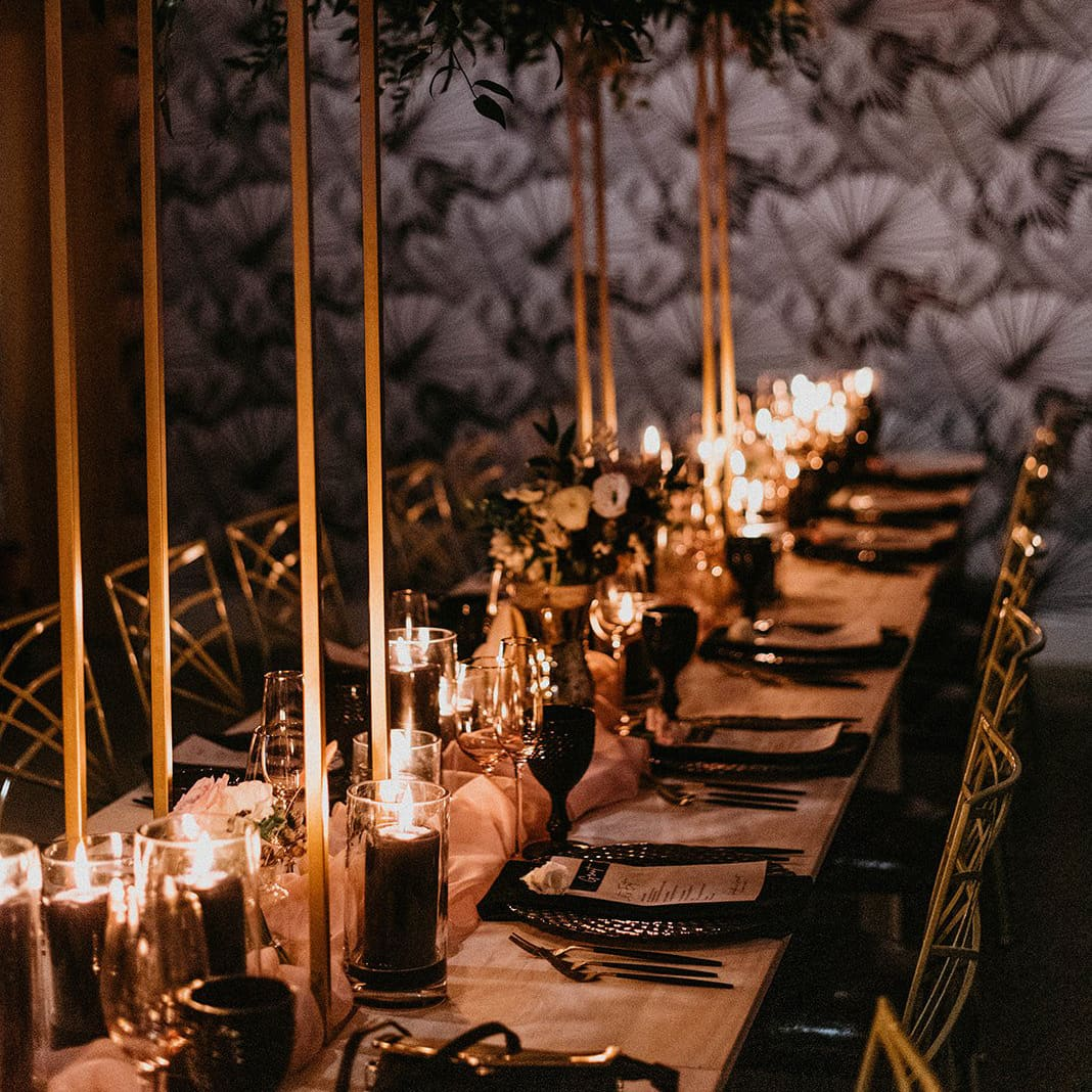Micro wedding dinner table with chairs and candles